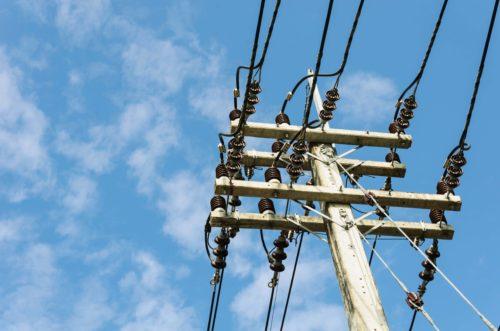 Electricity power pole and blue sky backgound